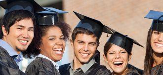 A diverse group of five graduates